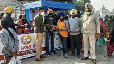 NPL celebrated Guru Nanak Dev's gurpurab by distributing road safety material